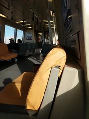 BART (Molly Des Jardin) Tags: bart metro lightrail transit publictransit oakland california train interior seats orange usa