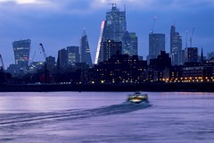 Late Boat To The City (Douguerreotype) Tags: blue london dark uk river water british buildings boat cityscape sunset lights architecture city thames britain night gb urban england