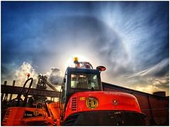 Standing idle (Andy Stones) Tags: kubota machinery diggers sun halo sky cloud cirrus industry nature naturephotography naturelovers natureseekers skywatching photography photoof image imageof imagecapture outdoors outside