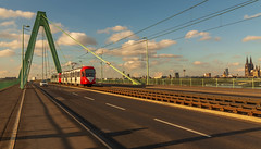 Severinsbrücke (Ian Emerson (Thanks for all the comments and faves) Tags: köln germany europe traction mixedtransport tram transport tracks severinsbrücke bridge canon6d outdoor suspensionbridge cathedral cityscape city clouds mrbluesky
