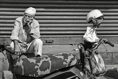 thinking about it (Dean Forbes) Tags: india bangalore man bw scooter helmet