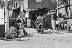 Going Home (Beegee49) Tags: street motorbike child back ad hoc housing monochrome blackandwhite man happy planet panasonic fz1000 bacolod city philippines asia