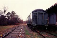 Railroad Nostalgia (NFE_0011) (masinka) Tags: etbtsy film analog photography nostalgia nostalgic moody train depot storage shed orchardpark ny newyork buffalo tracks railroad railway nikon fe fujicolor hq 200 color