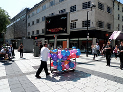 Moving the balloons (kevin Akerman) Tags: moving balloons advertising screen shops cardiff centre street