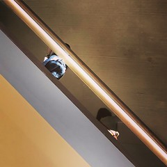 Leaning over (vapour trail) Tags: design museum london kensington room space wood level stairs people art