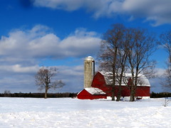 Red barn in snow (yooperann) Tags: trenary upper peninsula michigan alger county sunny day red barn silo trees snowy clouds