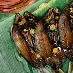 Grilled milkfish served on banana leaves thumbnail