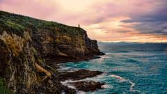 Taiaroa Head Lighthouse (Miradortigre) Tags: newzealand coast costa cliff peñascos riscos rocas acantilados mar sea sunset lighthouse faro nuevazelanda landscape paisaje paisagem