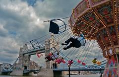 Exhilaratingly Alone (dylanawol66) Tags: europe london uk unitedkingdom england toweroflondon amusementparkride swing sky thamesriver river bridge cool londonbridge cloud