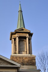Georgian Revival bell tower, Calvin Presbyterian Church, Deer Park, Toronto (edk7) Tags: nikond50 edk7 2006 canada ontario toronto northtoronto deerpark delislestreet calvinpresbyterianchurch wicksonandgregg1927 englishrenaissanceneoclassicalrevival architecture building oldstructure city cityscape urban church tower spire column capital stone stonework pediment sky tree georgianrevivalsubrenaissanceneoclassical ionic louvre louvres