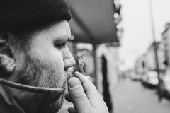 Sir Smokealot (Zesk MF) Tags: bw black white mono street smoke cigarette smoker fume bud beanie man rauchen zesk cologne x100f fuji collar