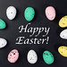 Painted Easter eggs in a circle with Happy Easter text