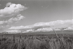 Utah Mountains in HP5 (iroc409) Tags: minolta xk rokkor 50mm ilford hp5 film 35mm blackandwhite bw landscape mountains fence