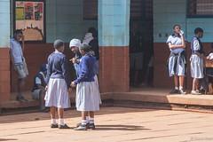 I'm Telling You - 5th July 2018 (princetontiger) Tags: kenya nairobi street streetphotography streetphotograpghy blue kangemi school children girls playground uniform breaktime