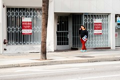 Available (www.karltonhuberphotography.com) Tags: 2018 citystreets downtown karltonhuber lady peoplewatching phone red santaana sidewalk signs southerncalifornia streetphotography urban walking woman