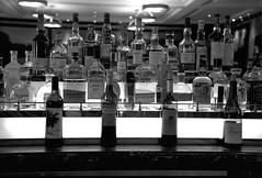Watering Hole  (Tmax 400) (Harald Philipp) Tags: bar club manhattan nyc bigapple newyork alcohol drinks tmax nikon f6 film analog monochrome bnw blackandwhite bw