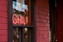 Chili at the Hard Times Cafe (John Brighenti) Tags: outdoors outside urban street photography alexandria virginia va oldtown brick sidwalk evening goldnenhour city downtown buildings walls roads businesses signs chili neon food restaurant cafe door window paionted wood glass reflection sony alpha a7rii ilce7rn2 sel70200g nex emount femount ilce zoom gmaster