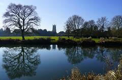 Abbey View (JamieHaugh) Tags: cirencester cotswolds gloucestershire nature outdoors abbey reflection sony alpha ilce7rm2 a7rii zeiss trees green river water sky afternoon sunshine blue light grass silhouette horizon buildings