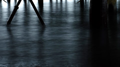 Under the pier (Andrew Malbon) Tags: sea shore longexposure fuji fujix xt1 architecture urbex pier funfair portsmouth southsea layers shadows lines blue dawn winter wet waves tripod 35mm structure columns