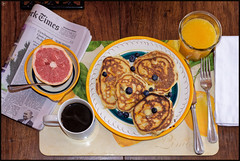 2019/005: Breakfast in America (Rex Block) Tags: breakfastinamerica nikon d750 dslr 50mm f18g project365 365the2019edition 3652019 day5365 05jan19 breakfast coffee juice grapefruit pancakes blueberries newspaper plate table linen napkin newyorktimes