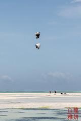 Kite-boarding (DragonSpeed) Tags: 28thkitsilanoscoutgroup 28thvancouverscoutgroup beachlife jambiani scouts scoutscanada tanzania tanzaniaexpedition2018 venturerscouts venturers zanzestbeachbungalows zanzibar exploring lowtide tidalflats zanzibarsouthcentral tz