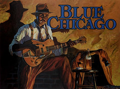 The Rambler (Anthony Mark Images) Tags: therambler bluechicago bluesclub painting postcard hat litcigarette hollowbodyelectricguitar stool beer cigarettepack suspenders tie moustache male man guitarplayer bluesmusic chicago illinois usa shadow art nikon d850 blues music johncarrolldoyle