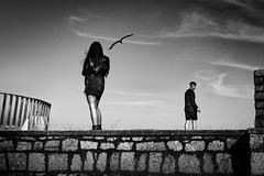 Never look back (Kieron Ellis) Tags: man woman seagull bird sky sunny bright contrast seafront wall railing bag people looking candid street blackandwhite blackwhite monochrome absoluteblackandwhite