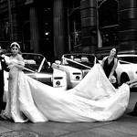 Wow, that's what I call a wedding dress drag, not to mention the cars! thumbnail