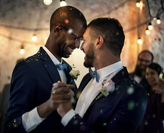 Gay couple dancing on wedding day (DJ Climactic) Tags: groom lgbt gay homosexual samesex marriage wedding love equality sweet closeness dancing affection romance romantic smiling cheerful enjoying dance stare happiness tuxedo couple partners relationship men guy black diverse people celebration togetherness union party newlywed unitedkingdomofgreatbritainandnorthernireland