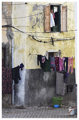 Laundry day in El Jadida.... (wirehn) Tags: laundry eljadida window clothes house colors lines bucket