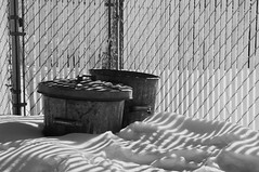 Two Cans (Solojoe) Tags: trash two trashcans twocans shadows winter sunlight ir infrared 590nm monochrome blackwhite bw fence d300s snow supercolor590nm supercolorconversion supercolor