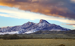 Clearing Skies (wyojones) Tags: wyoming hills sky clouds cloudscape sunset snow landscape dusk eventide bighornbasin grass