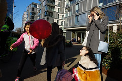 King's Cross, London. 2019 (jaumescar) Tags: streetphoto shadows people london human canpubphoto inpublic sunny light color street photography baloon red kids family fun composition running sunglasses