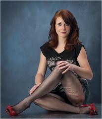 Sammy-129 (AndyG01) Tags: pretty girl fishnet tights redhead red highheels shortskirt denim skirt studio photoshoot