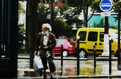 taking sides (*F~) Tags: paris france rain pluie babylonia humans people man running searching protection shelter traffic urban city garedausterlitz self other life solitude colors moment