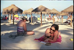 Spain 2018 - Kodak Retina IIc (Type 020) - My lovely wife Lisa on the beach with dappled sunlight (Gareth Wonfor (TempusVolat)) Tags: lisa lisawonfor lisafarge garethwonfor tempusvolat gareth wonfor tempus volat mrmorodo wife beautifulwife beautiful pretty prettywife bikini beach gorgeous spain holiday vacance 2018 sunglasses brunette sand bluesky reading reader necklace attractive girl woman dappled evening sun kodak retina film 35mm scan scanned scanning scanner scans epson perfection v200 girls women mywife bikiniwife parasols parasol sea curvy curves beauty mygirl beachgirl summer summertime glasses eyewear cleavage read