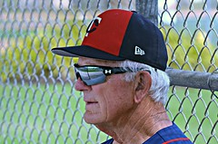 Portrait of a Baseball Lifer : Phil Roof at Home in the Dugout (forestforthetress) Tags: philroof minnesotatwins baseball man hat uniform glasses omot nikon outdoor color fortmyers hammondstadium face unlimitedphotos