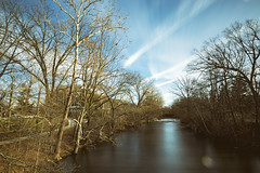 Red Cedar River Blues (matthewkaz) Tags: redcedar river redcedarriver water longexposure ndfilter reflection reflections flare sky clouds trees contrail contrails chemtrail chemtrails msu michiganstateuniversity college campus hannahadministrationbuilding eastlansing inghamcounty michigan rapids 2019