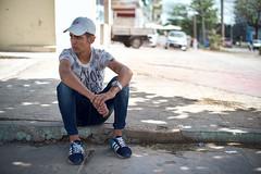 Young man sitting (ckilger) Tags: color havanna leicam10 cuba overgaardworkshop summiluxm11450asph mann sitzend bokeh baseballcap kappe blick adidas armbanduhr tshirt jeans