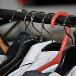 Shirts hanging on different clothes hangers thumbnail