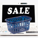 Shopping basket on a laptop with sale text thumbnail