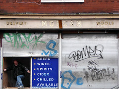drapery (steve marland) Tags: door window shopfront shop abandoned closed shutters sign signage ghostsign typography words text graphicdesign grafitti manchester uk england urban urbandecay levenshulme