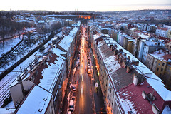 Jaromirova street: Winter (Pavel's Snapshots) Tags: prague praha czech czechrepublic evening dusk snow winter street straight traffic roof roofs house houses residential area district rooftop view panorama panoramic nikon nikkor d750 24mm white orange density town city urban old historical historic distant valley lights cold vysehrad road path europe european aerial traditional architecture cars