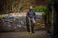 Badass Mark, Bristol, UK (KSAG Photography) Tags: portrait urban urbandecay man person bristol uk unitedkingdom england europe city night nightphotography nikon 35mm wideangle graffiti bricks wall february 2019 winter