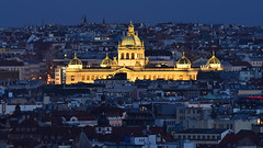 The National Museum - 1 of 2 (Pavel's Snapshots) Tags: museum national palace neorenaissance prague praha czech czechrepublic illumination lighting night evening dusk late blue yellow vivid dark different houses city town urban capital nikon nikkor d750 300mm crop dx building major standsout density view distant buildings architecture old historic historical europe european sky travel tourism roofs aerial spires gold golden dome domes area district starbucks