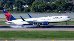 MSP N180DN (Moments In Flight) Tags: minneapolisstpaulinternationalairport msp kmsp mspairport boeing 767 767300er 767332er deltaairlines n180dn aviation avgeek airplane tiresmoke landing