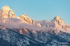 Grand, Owen, and Teewinot (kevin-palmer) Tags: december winter cold snow snowy grandtetonnationalpark tetons mountains morning sunrise dawn nikon180mmf28 telephoto clouds albrightoverlook grandteton sunlight blue sky mountowen nikond750 teewinotmountain gold golden