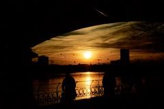 Early Spring Hamburg (Geolilli) Tags: hamburg bridge tunnel sunset golden light people germany lake alster iron fence park evening canon