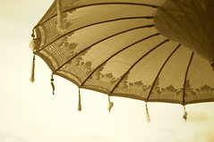 Sepia picture of an Asian umbrella (Marlon.Trottmann) Tags: indonesia culture symbol asian religion religious background holiday traditional decoration asia temple umbrella exotic beautiful balinese spiritual exoticism fabric tradition art decor faith wake travel textile handmade custom color ceremony ritual decorate harmony bali ornament decorated lowangleview sepia jimbaran beach parasol protection sun handcrafted tassels relax relaxation hindu