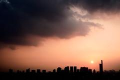 Close of day (Rob₊Lee) Tags: silhouette sundown sun clouds dark sunset orange hue buildings distance sky negativespace space